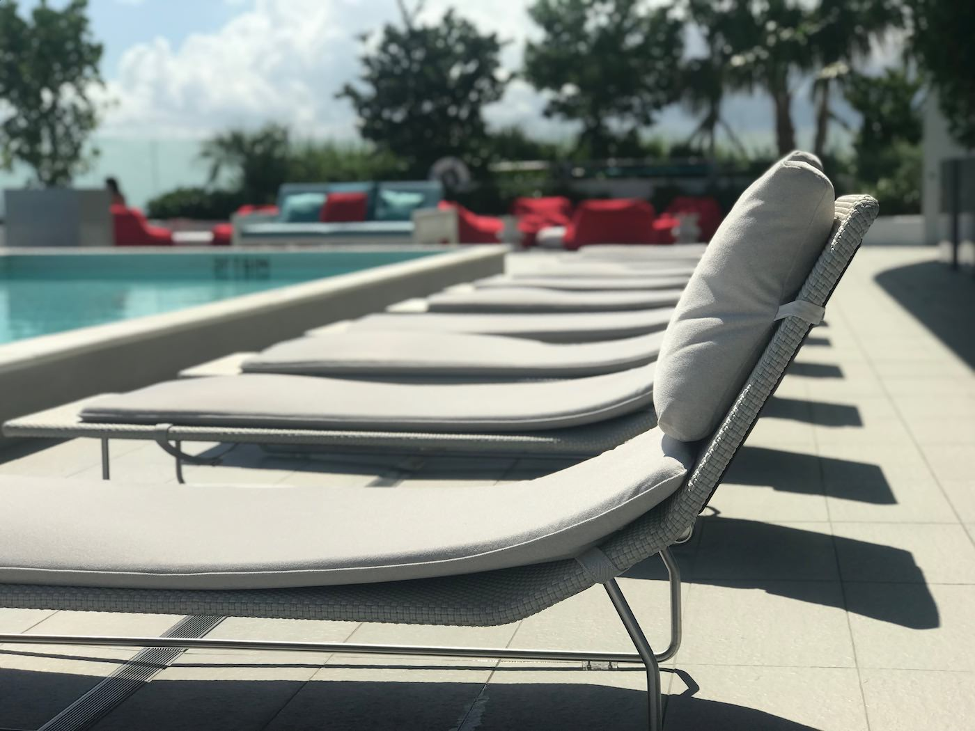 Lounge chairs by rooftop pool